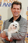 UNIVERSAL CITY, CA. - May 31: Chris Isaac and his dog Rodney arrive at the 2009 MTV Movie Awards at the Gibson Amphitheatre on May 31, 2009 in Universal City, California.