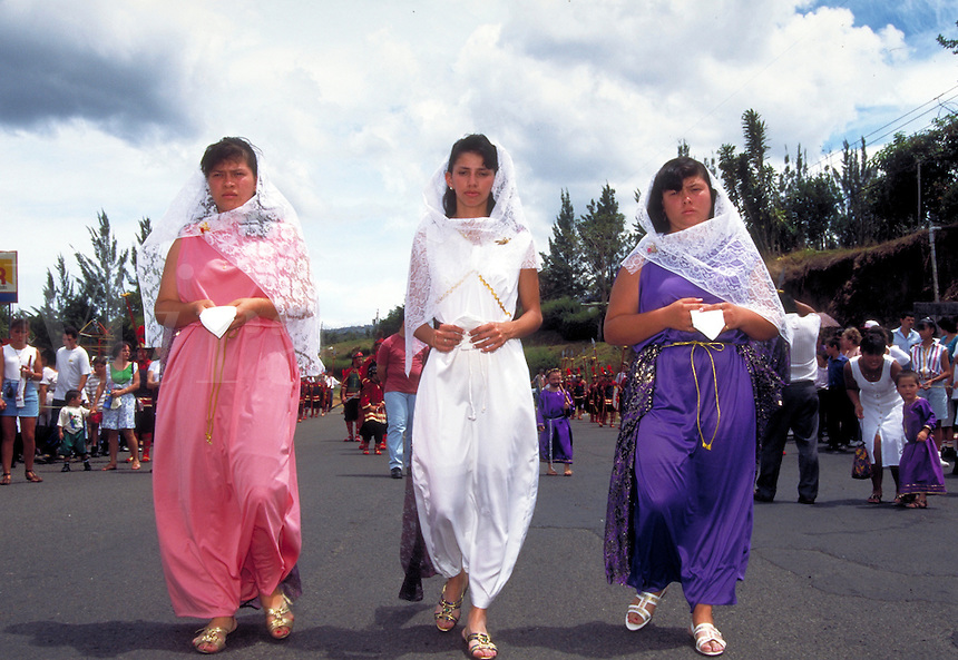 Three maidens at Easter procession in Costa Rica. Santa Barbara, Costa Rica.