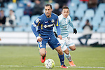Getafe's Mehdi Lacen (l) and Celta de Vigo's Fabian Orellana during La Liga match. February 27,2016. (ALTERPHOTOS/Acero)
