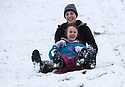 21/01/18<br /> <br /> Chlo&eacute; Kirkpatrick (25) and Freya Kirkpatrick (10) sledge down a snowy hillside near Dovedale in the Derbyshire Peak District..<br /> <br /> All Rights Reserved: F Stop Press Ltd. +44(0)1773 550665  www.fstoppress.com.