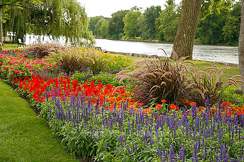 Fox River flows near a park flower garden in Geneva Illinois
