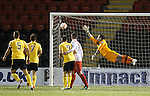 Airdrie keeper Kenny Arthur is helpless as Liam Fox's free-kick sails into the top corner of the net for Livingston's second goal of the match