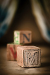Three wooden alphabet blocks