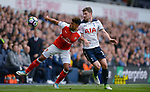 Alex Oxlade-Chamberlain of Arsenal is challenged by Ben Davies of Tottenham Hotspur during the English Premier League match at the White Hart Lane Stadium, London. Picture date: April 30th, 2017.Pic credit should read: Robin Parker/Sportimage