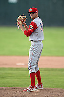 Williamsport Crosscutters pitcher Calvin Rayburn (26) gets ready to deliver a pitch during the first game of a doubleheader against the Batavia Muckdogs on July 29, 2014 at Dwyer Stadium in Batavia, New York.  Williamsport defeated Batavia 3-2.  (Mike Janes/Four Seam Images)