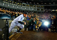 Mariners' right fielder and leadoff hitter Ichiro Suzuki runs onto the field during player introductions prior to the start of the game on opening day of the 2006. (Photo by Scott Eklund)