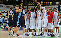 Team Huddle by GB while Bosnia & Herzegovina celebrate during the EuroBasket 2015 2nd Qualifying Round Great Britain v Bosnia & Herzegovina (Euro Basket 2nd Qualifying Round) at Copper Box Arena in London. - 13/08/2014