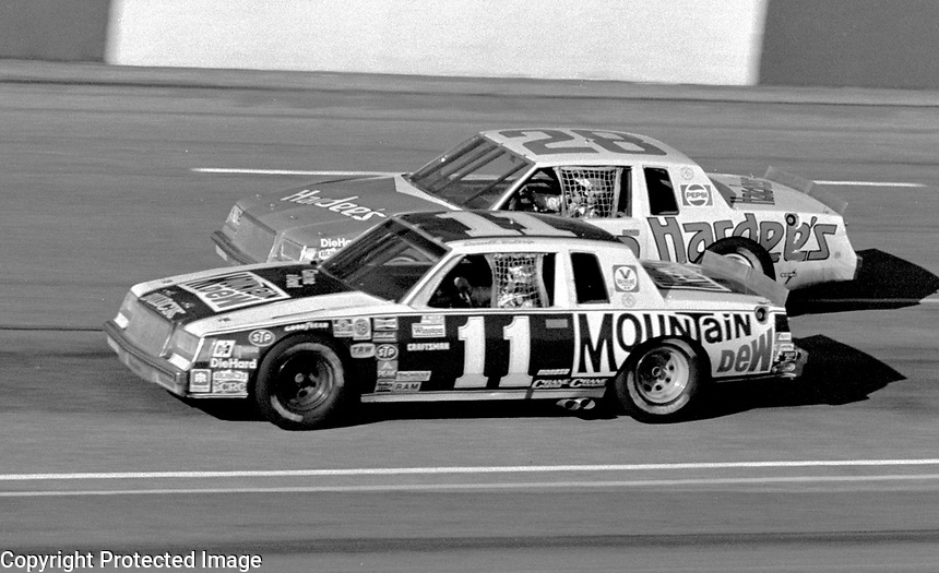 Darrell Waltrip and Cale Yarborough race side by side into turn three at Atlanta in November 1981. (Photo by Brian Cleary)