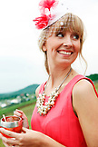 USA, Tennessee, Nashville, Iroquois Steeplechase, woman drinking Moonshine Cherry-Basil Blush