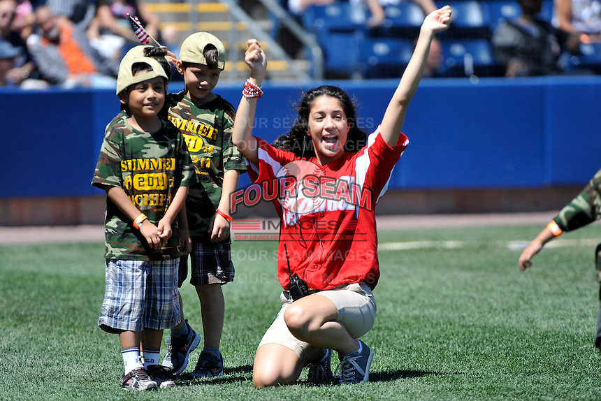 Staten Island Yankees fans having fun with the flag tag relay during a game against the State College Spikes at Richmond County Bank Ballpark at St. George on July 14, 2011 in Staten Island, NY.  Staten Island defeated State College 6-4.  Tomasso DeRosa/Four Seam Images