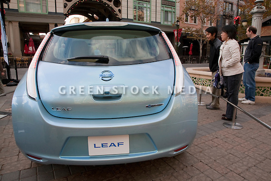 Rear View Of Electric Car Nissan Leaf Zero Emission Tour Green