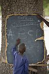 A boy points to letters on a blackboard in the Loreto Primary School in Rumbek, South Sudan. The Loreto Sisters began a secondary school for girls in 2008, with students from throughout the country, but soon after added a primary in response to local community demands.