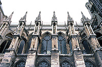 Rheims: Notre Dame Cathedral. Aisles buttresses, north side. Note: no stained glass--WWI damage. Photo '87.