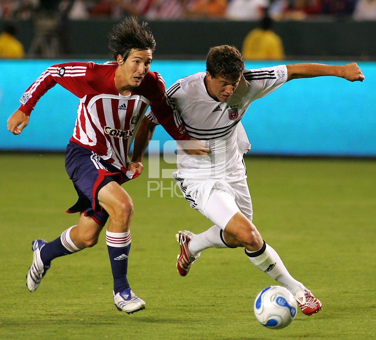 CD Chivas USA midfielder Sacha Kljestan (16) battles DC United defender Marc Burch (4) for the ball. CD Chivas USA tied D. C. United 2-2 during an MLS regular season match at the Home Depot Center, Carson, CA, on September 6, 2007.