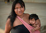 A Warao indigenous mother and child in Boa Vista, Brazil. They are refugees from Venezuela, living in a park that they and other Warao refugee families invaded. They had previously been sheltered in a government refuge, but found the military-controlled environment oppressive. So they moved out and set up their own refuge in the park, where they receive some support from local Catholics.