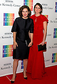 Rose Kennedy Schlossberg and Tatiana Schlossberg, daughters of Ambassador Caroline Kennedy, arrive for the formal Artist's Dinner honoring the recipients of the 2014 Kennedy Center Honors hosted by United States Secretary of State John F. Kerry at the U.S. Department of State in Washington, D.C. on Saturday, December 6, 2014. The 2014 honorees are: singer Al Green, actor and filmmaker Tom Hanks, ballerina Patricia McBride, singer-songwriter Sting, and comedienne Lily Tomlin.<br /> Credit: Ron Sachs / Pool via CNP
