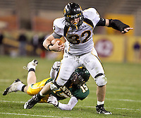 1129101140jlw  4A1foot1205  Saguaro's Turner Lace (CQ) is tackled by Canyon del Oro's Robert Metz (CQ) during the 4AI State Championship Saturday at Sun Devil Stadium. (Pat Shannahan/ The Arizona Republic)