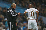 Swansea's care-taker manager Alan Curtis and Swansea's Andre Ayew - Manchester City vs Swansea - Barclays Premier League - Etihad Stadium - Manchester - 12/12/2015 Pic Philip Oldham/SportImage