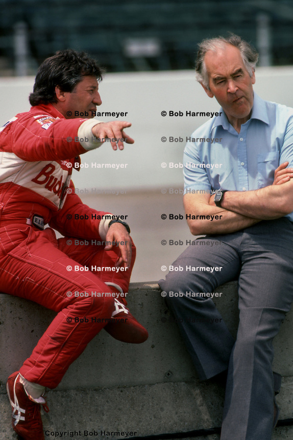 INDIANAPOLIS, IN - MAY 29: Mario Andretti (left) speaks with Lola designer Eric Broadley during a break in practice for the Indianapolis 500 on May 29, 1993, at the Indianapolis Motor Speedway in Indianapolis, Indiana.