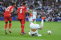 Cardiff City Stadium, Cardiff, South Wales - Tuesday 12th Aug 2014 - UEFA Super Cup Final - Real Madrid v Sevilla - <br /> <br /> Real Madrid&rsquo;s Christiano Ronaldo takes a heavy tackle and ends up upside down. <br /> <br /> <br /> <br /> <br /> Photo by Jeff Thomas/Jeff Thomas Photography