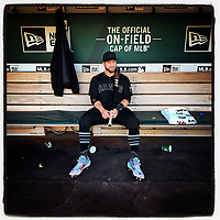 OAKLAND, CA - AUGUST 24: iPhone Instagram of Stephen Vogt of the San Francisco Giants sitting in the dugout before the game against the Oakland Athletics at the Oakland Coliseum on August 24, 2019 in Oakland, California. (Photo by Brad Mangin)