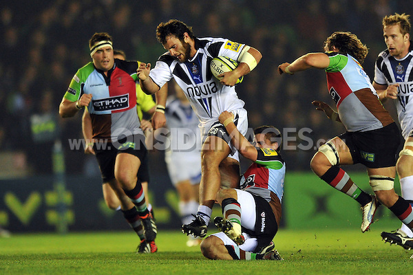 Charlie Beech is tackled in possession. LV= Cup match, between Harlequins and Bath Rugby on November 16, 2012 at the Twickenham Stoop in London, England. Photo by: Patrick Khachfe / Onside Images