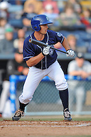 Asheville Tourists designated hitter Michael Benjamin #18 squares to bunt during a game against the Delmarva Shorebirds at McCormick Field on April 5, 2014 in Asheville, North Carolina. The Tourists defeated the Shorebirds 5-3. (Tony Farlow/Four Seam Images)
