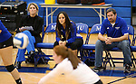 From left, Marymount Head Coach Beth Ann Wilson and Assistant Coaches Johannah Zabal and Victor Troyan watch a college volleyball match against PSU Harrisburg at Marymount University in Arlington, Vir., on Wednesday, Oct. 9, 2013.<br /> Photo by Cathleen Allison