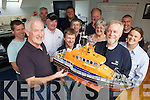 Englishman Keith Baxter donated a miniature All Weather Lifeboat to Fenit RNLI on Friday. Pictured were: Gerard O'Donnell, John J Moriarty, Diane Baxter, Kevin Moriarty, John Deady, Billy Moriarty, Guy Waugh, Kevin Honeyman, Finbarr O'Connell, Adrian O'Connell and Denise Lynch.