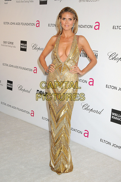 Heidi Klum (wearing Julien Macdonald).21st Annual Elton John Academy Awards Viewing Party held at West Hollywood Park, West Hollywood, California, USA..February 24th, 2013.oscars full length gold diamante sequins sequined dress beads beaded art deco plunging neckline cleavage hands on hips.CAP/ADM/BP.©Byron Purvis/AdMedia/Capital Pictures.