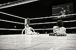 A wrestler slumps in the corner after as his opponent looks on during a bout at Doglegs, an event for wrestlers with physical and mental handicaps in Tokyo, Japan.