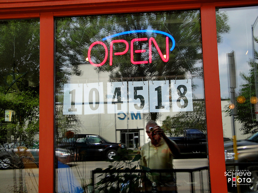That's me outside a Madison, Wisconsin restaurant that specializes in cupcakes - 104,518 sold!