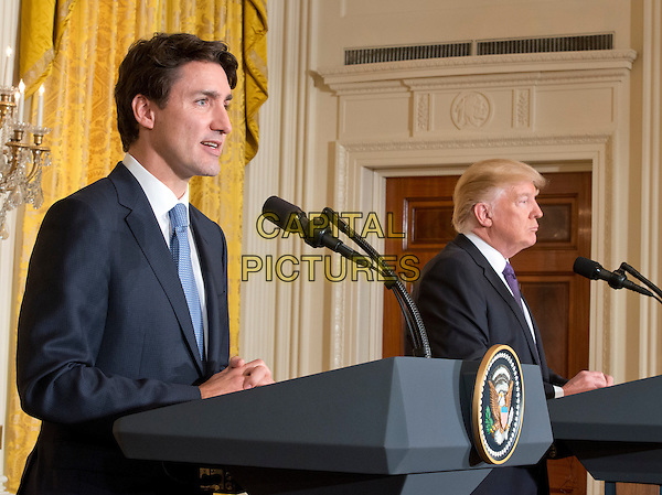 United States President Donald J. Trump, right, and Prime Minister Justin Trudeau of Canada, left, conduct a joint press conference in the East Room of the White House in Washington, DC on Monday, February 13, 2017.<br /> CAP/MPI/CNP/RS<br /> &copy;RS/CNP/MPI/Capital Pictures
