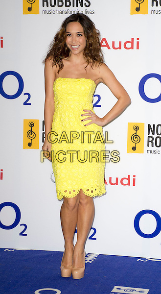 Myleene Klass<br /> Nordoff Robbins Silver Clef Awards at the Hilton, Park Lane, London, UK, June 28th 2013.<br /> full length yellow strapless lace dress platform nude beige shoes  hand on hip <br /> CAP/PP/GM<br /> &copy;Gary Mitchell/PP/Capital Pictures