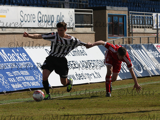 Ross Meechan being pulled back by Kieran Gibbons in the Aberdeen v St Mirren Clydesdale Bank Scottish Premier League Under 20 match played at Balmoor Stadium, Peterhead on 19.4.13.