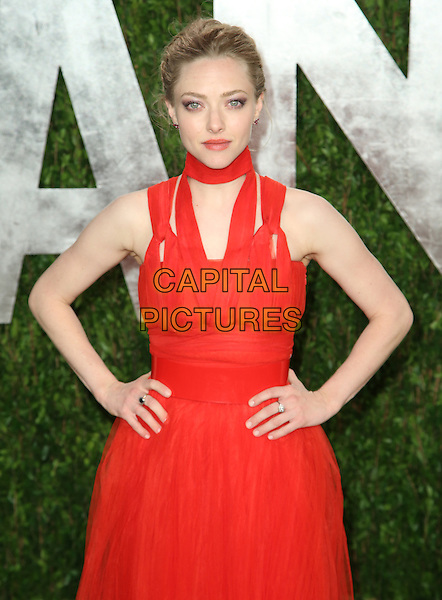 Amanda Seyfried.2013 Vanity Fair Oscar Party following the 85th Academy Awards held at the Sunset Tower Hotel, West Hollywood, California, USA..February 24th, 2013.oscars half length red dress hands on hips high collar .CAP/ADM/SLP/DOW.©Dowling/StarlitePics/AdMedia/Capital Pictures
