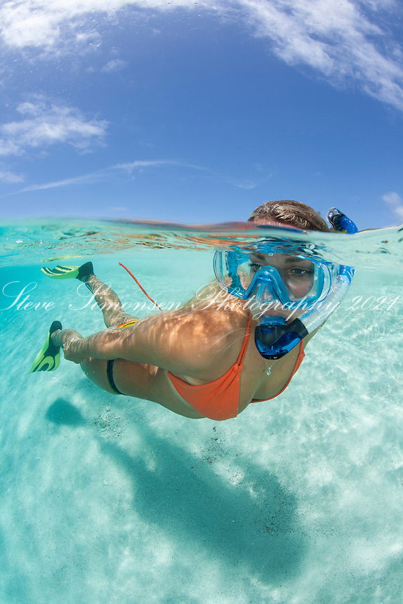 Snorkeler in crystal clear Caribbean water<br />