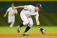 Rice Owls shortstop Ford Stainback #11 charges a ground ball against the \rr\ at Minute Maid Park on March 3, 2012 in Houston, Texas.  The Owls defeated the Red Raiders 6-2.  Brian Westerholt / Four Seam Images
