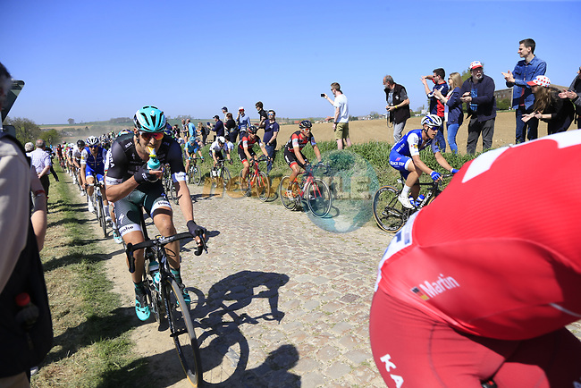 The peloton including Marcus Burghardt (GER) Bora-Hansgrohe on pave sector 25 Briastre a Solesmes during the 115th edition of the Paris-Roubaix 2017 race running 257km Compiegne to Roubaix, France. 9th April 2017.<br /> Picture: Eoin Clarke | Cyclefile<br /> <br /> <br /> All photos usage must carry mandatory copyright credit (&copy; Cyclefile | Eoin Clarke)