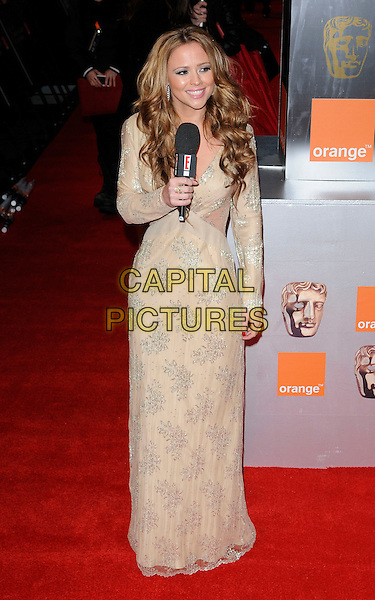 KIMBERLEY WALSH (Girls Aloud).Attending the Orange British Academy Film Awards (BAFTAs), Royal Opera House, Covent Garden, London, England, UK, February 13th 2011..arrivals full length long maxi dress beige silver print patterned dress sleeve microphone .CAP/CAN.©Can Nguyen/Capital Pictures.