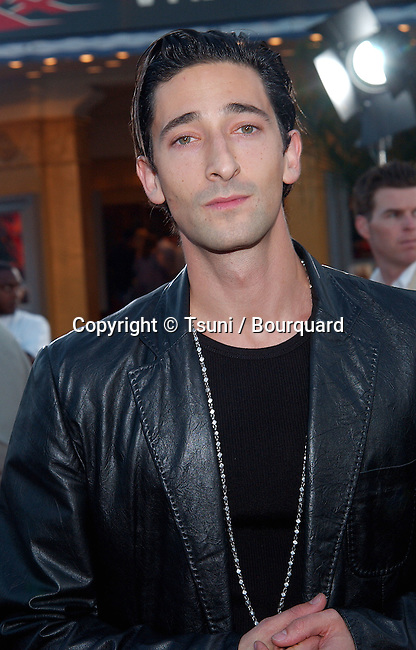 Adrien Brody arriving at the premiere of  of xXx (triple X) at The Westwood Village Theatre in Los Angeles. August 5, 2002.