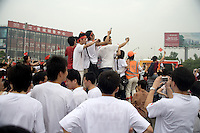 Spectators watch the Nanjing, China, leg of the 2008 Olympic Torch Relay.