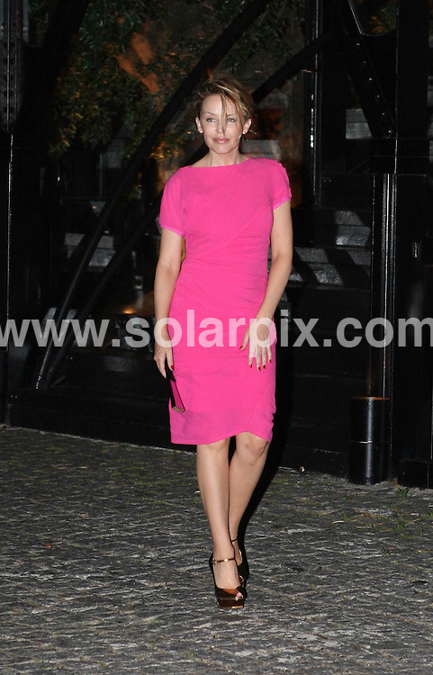 """**ALL ROUND PICTURES FROM SOLARPIX.COM**.**WORLDWIDE SYNDICATION RIGHTS EXCLUDING SPAIN & PORTUGAL****NO SPAIN & PORTUGAL**.Kylie Minogue wearing a bright pink dress after having dinner at the restaurant """"Kais"""" in Lisbon, Portugal..JOB REF:   9418    NPP      DATE:  04.07.09.**MUST CREDIT SOLARPIX.COM OR DOUBLE FEE WILL BE CHARGED**.**ONLINE USAGE FEE GBP 50.00 PER PICTURE - NOTIFICATION OF USAGE TO PHOTO @ SOLARPIX.COM**.**CALL SOLARPIX : +34 952 811 768 or LOW RATE FROM UK 0844 617 7637**"""