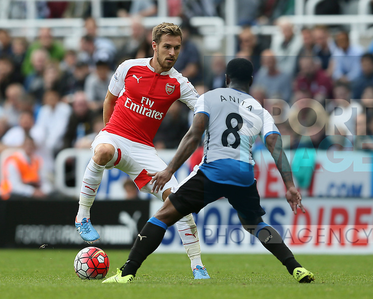Aaron Ramsey of Arsenal stopped by Vurnon Anita of Newcastle United - English Premier League - Newcastle Utd v Arsenal - St James' Park Stadium - Newcastle - England - 28th August 2015 - Picture Simon Bellis/Sportimage