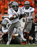 12/04/10-- Oregon running back Kenjon Barner runs through the Oregon State defense and heads upfield for a touchdown in the second half of the Civil War game at Reser Stadium in Corvallis, Or..Photo by Jaime Valdez