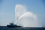 Firefighting ship in Gloucester harbor celebrating the arrival of tall ships for the Mayors race.
