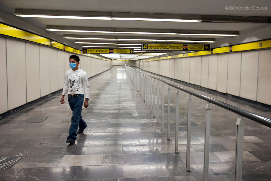 April 26, 2009 - Metro station, Mexico City, Mexico - A resident of Mexico City walks in the metro which would normally be packed with people. Photo credit: Benedicte Desrus / Sipa Press