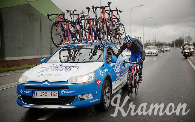 Mirko Selvaggi (ITA/Wanty-Groupe Gobert) gets back to the teamcar to get some more rain gear<br /> <br /> 70th Dwars Door Vlaanderen 2015