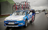 Mirko Selvaggi (ITA/Wanty-Groupe Gobert) gets back to the teamcar to get some more rain gear<br /> <br /> 70th Dwars Door Vlaanderen 2015