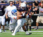 SIOUX FALLS, SD - SEPTEMBER 5: Josh Angulo #8 from the University of Sioux Falls is brought down by Preston Tescher #30 from the University of Mary in the first half of their game Saturday afternoon at Bob Young Field.  (Photo by Dave Eggen/Inertia)